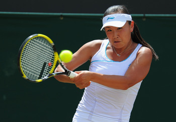 LONDON, ENGLAND - JUNE 27:  Shuai Peng of China in action during her fourth round match against Maria Sharapova of Russia on Day Seven of the Wimbledon Lawn Tennis Championships at the All England Lawn Tennis and Croquet Club on June 27, 2011 in London, E