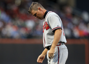 NEW YORK, NY - JUNE 03: Chipper Jones #10 of the Atlanta Braves looks down after being left on base against the New York Mets at Citi Field on June 3, 2011 in the Flushing neighborhood of the Queens borough of New York City.  (Photo by Nick Laham/Getty Im