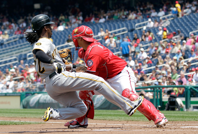 WASHINGTON, DC - JULY 03: Catcher Wilson Ramos #3 of the Washington Nationals waits for the throw as Andrew McCutchen #22 of the Pittsburgh Pirates scores during the second inning at Nationals Park on July 3, 2011 in Washington, DC.  (Photo by Rob Carr/Ge