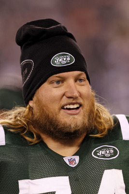 EAST RUTHERFORD, NJ - NOVEMBER 25: Nick Mangold #74 of the New York Jets stands on the sideline during the game against the Cincinnati Bengals at New Meadowlands Stadium on November 25, 2010 in East Rutherford, New Jersey. The Jets defeated the Bengal 26-