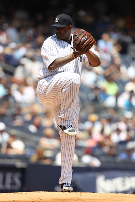 NEW YORK, NY - JUNE 25:  CC Sabathia #52 of the New York Yankees pitches against the Colorado Rockies during their game on June 25, 2011 at Yankee Stadium in the Bronx borough of New York City.  (Photo by Al Bello/Getty Images)