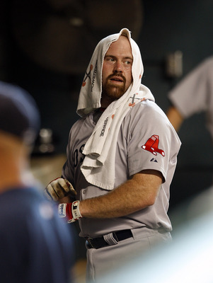 HOUSTON - JULY 03:  Kevin Youkilis #20 of the Boston Red Sox looks on from the dugout during a baseball game against the Houston Astros at Minute Maid Park on July 3, 2011 in Houston, Texas.  (Photo by Bob Levey/Getty Images)