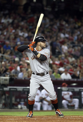 PHOENIX, AZ - JUNE 14:  Cody Ross #13 of the San Francisco Giants bats against the Arizona Diamondbacks during the Major League Baseball game at Chase Field on June 14, 2011 in Phoenix, Arizona. The Giants defeated the Diamondbacks 6-5.  (Photo by Christi