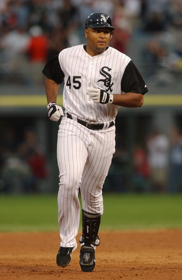 CHICAGO - JULY 9:  Carlos Lee #45 of the Chicago White Sox runs during the game against the Seattle Mariners on July 9, 2004 at U.S. Cellular Field in Chicago, Illinois.  The White Sox defeated the Mariners 6-2.  (Photo by Jonathan Daniel/Getty Images)