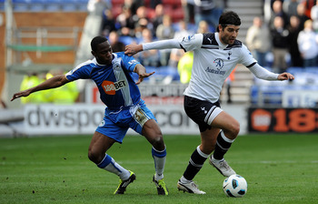 WIGAN, ENGLAND - APRIL 02: Maynor Figueroa of Wigan Athletic(L) competes with Vedran Corluka of Tottenham Hotspur during the Barclays Premier League match between Wigan Athletic and Tottenham Hotspur at DW Stadium on April 2, 2011 in Wigan, England.  (Pho