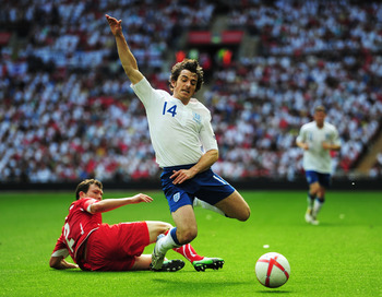 LONDON, ENGLAND - JUNE 04:  Stephan Lichtsteiner of Switzerland (L) tackles Leighton Baines of England during the UEFA EURO 2012 group G qualifying match between England and Switzerland at Wembley Stadium on June 4, 2011 in London, England.  (Photo by Jam