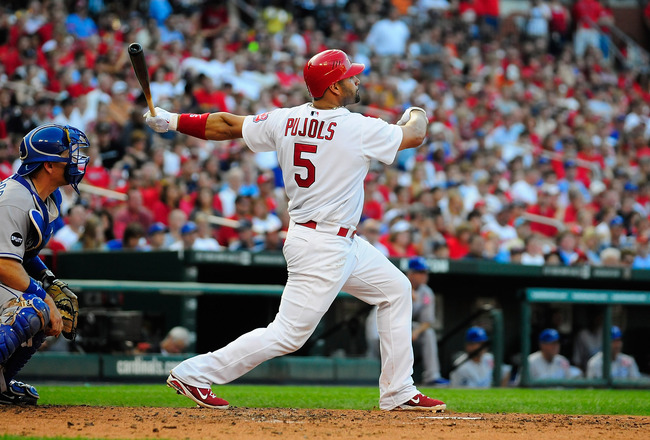 ST. LOUIS, MO - JUNE 18: Albert Pujols #5 of the St. Louis Cardinals follows through on a one run double against the Kansas City Royals at Busch Stadium on June 18, 2011 in St. Louis, Missouri.  (Photo by Jeff Curry/Getty Images)