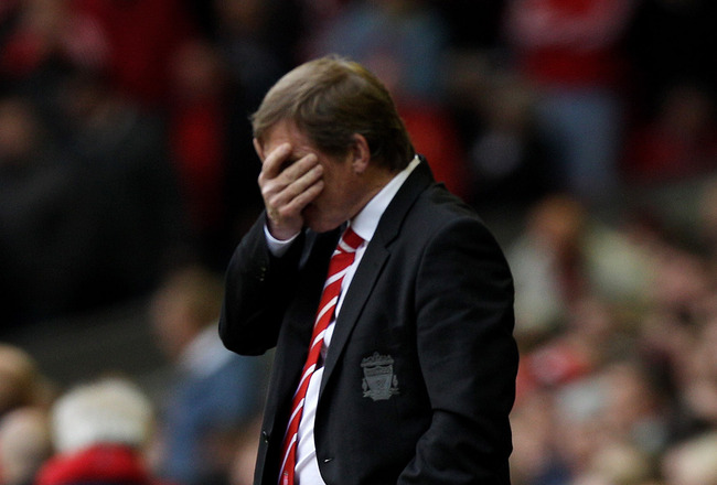LIVERPOOL, ENGLAND - MAY 15:  A dejected Kenny Dalglish the Liverpool manager looks on as his team head towards a 2-0 defeat during the Barclays Premier League match between Liverpool and Tottenham Hotspur at Anfield on May 15, 2011 in Liverpool, England.