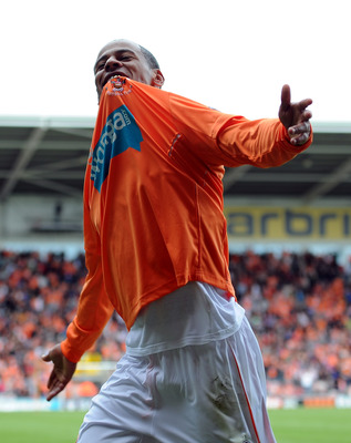 BLACKPOOL, ENGLAND - MAY 14:  DJ Campbell of Blackpool celebrates scoring his side's third goal during the Barclays Premier League match between Blackpool and Bolton Wanderers at Bloomfield Road on May 14, 2011 in Blackpool, England.  (Photo by Chris Brun