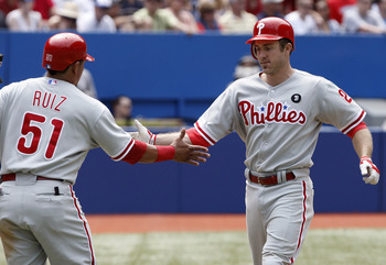 TORONTO, CANADA - JULY 2: Chase Utley #26 celebrates his run with Carlos Ruiz #51 of the Philadelphia Phillies during MLB action against the Toronto Blue Jays  at The Rogers Centre July 2, 2011 in Toronto, Ontario, Canada. (Photo by Abelimages/Getty Image