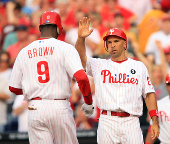 PHILADELPHIA - JUNE 10: Right fielder Domonic Brown #9 of the Philadelphia Phillies is congratulated by left fielder Raul Ibanez #29 after hitting a home run during a game against the Chicago Cubs at Citizens Bank Park on June 10, 2011 in Philadelphia, Pe