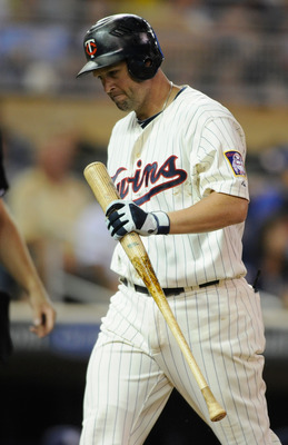 MINNEAPOLIS, MN - JULY 1: Michael Cuddyer #5 of the Minnesota Twins reacts to a strike out by Zach Braddock #21 of the Milwaukee Brewers in the eighth inning on July 1, 2011 at Target Field in Minneapolis, Minnesota. The Twins defeated the Brewers 6-2. (P