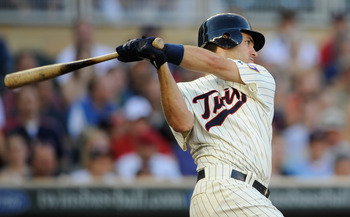 MINNEAPOLIS, MN - JUNE 28: Joe Mauer #7 of the Minnesota Twins hits an RBI single against the Los Angeles Dodgers in the first inning on June 28, 2011 at Target Field in Minneapolis, Minnesota. (Photo by Hannah Foslien/Getty Images)