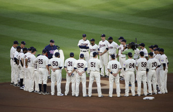 MINNEAPOLIS, MN - MAY 23: Manager Ron Gardenhire #35 of the Minnesota Twins speaks about the late Hall of Famer Harmon Killebrew while the rest of the Minnesota Twins stand around Killebrew's number in the infield dirt behind second base prior to a game a