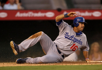 ANAHEIM, CA - JULY 01:  Andre Ethier #16 of the Los Angeles Dodgers slides home with a run in the third inining against the Los Angeles Angels of Anaheim on July 1, 2011 at Angel Stadium in Anaheim, California.  (Photo by Stephen Dunn/Getty Images)
