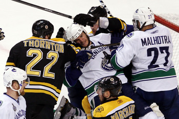 BOSTON, MA - JUNE 13:  Shawn Thornton #22 of the Boston Bruins fights with Kevin Bieksa #3 of the Vancouver Canucks during Game Six of the 2011 NHL Stanley Cup Final at TD Garden on June 13, 2011 in Boston, Massachusetts.  (Photo by Bruce Bennett/Getty Im