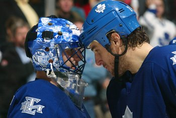 TORONTO - NOVEMBER 20:  Pavel Kubina #73 of the Toronto Maple Leafs congratulates goaltender Andrew Raycroft #1 with a tap on the helmet during their NHL game against the New York Islanders at Air Canada Centre on November 20, 2006 in Toronto, Ontario. Th