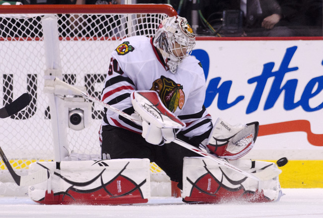 VANCOUVER, CANADA - APRIL 26: Goalie Corey Crawford #50 of the Chicago Blackhawks makes a pad save against the Vancouver Canucks during the second period in Game Seven of the Western Conference Quarterfinals during the 2011 NHL Stanley Cup Playoffs on Apr
