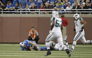 DETROIT - NOVEMBER 07:  Matthew Stafford #9 of the Detroit Lions lays on the ground after being sacked by Bryan Thomas #58 of the New York Jets during the third quarter of the game at Ford Field on November 7, 2010 in Detroit, Michigan. The Jets defeated