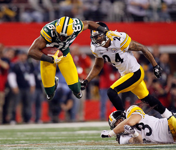 ARLINGTON, TX - FEBRUARY 06: Greg Jennings #85 of the Green Bay Packers catches a 31 yard pass in the fourth quarter against the Pittsburgh Steelers during Super Bowl XLV at Cowboys Stadium on February 6, 2011 in Arlington, Texas.  (Photo by Kevin C. Cox/