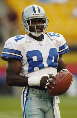 PITTSBURGH - AUGUST 21:  Wide receiver Joey Galloway #84 of the Dallas Cowboys holds the ball prior to the preseason game against the Pittsburgh Steelers at Heinze Field on August 21, 2003 in Pittsburgh, Pennsylvania. The Steelers defeated the Cowboys 15-