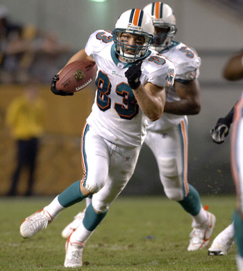 Miami Dolphins  wide receiver Wes Welker returns a kick against the Pittsburgh Steelers in the NFL's opening 2006 game on September 7, 2006 at Heinz Field in Pittsburgh, Pennsylvania.  (Photo by Al Messerschmidt/Getty Images)