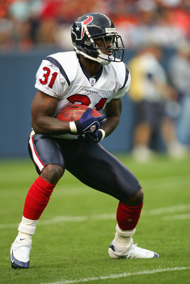 DENVER - AUGUST 27:  Phillip Buchanon #31 of the Houston Texans looks to run with the ball against the Denver Broncos during their preseason NFL game at Invesco Field at Mile High on August 27, 2006 in Denver, Colorado.  The Broncos defeated the Texans 17