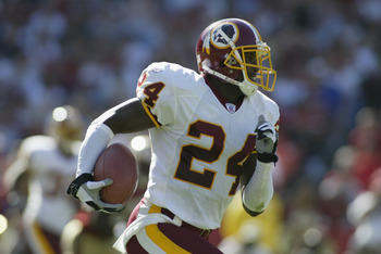 SAN FRANCISCO - SEPTEMBER 22:  Cornerback Champ Bailey #24 of the Washington Redskins runs the ball against the San Francisco 49ers during the NFL game on September 22, 2002 at Candlestick Park in San Francisco, California.  The 49er's won 20-10.  (Photo 