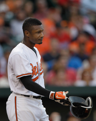 BALTIMORE, MD - JUNE 30: Adam Jones #10 of the Baltimore Orioles tosses his helmet after striking out swining to end the first inning against the St. Louis Cardinals at Oriole Park at Camden Yards on June 30, 2011 in Baltimore, Maryland.  (Photo by Rob Ca