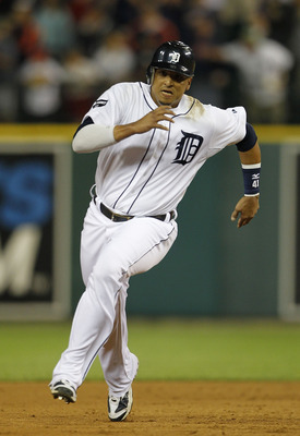 DETROIT - JUNE 13:  Victor Martinez #41 of the Detroit Tigers scores the game winning run in the tenth inning on a triple from Ramon Santiago #39 after his as the Tigers defeated the Tampa Bay Rays 2-1 at Comerica Park on June 13, 2011 in Detroit, Michiga