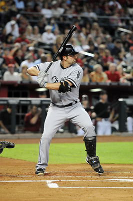 PHOENIX, AZ - JUNE 18:  Paul Konerko #14 of the Chicago White Sox gets ready in the batters box against the Arizona Diamondbacks at Chase Field on June 18, 2011 in Phoenix, Arizona.  (Photo by Norm Hall/Getty Images)