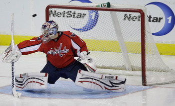 WASHINGTON, DC - MARCH 29:  Semyon Varlamov #1 of the Washington Capitals deflects a shot during the third period against the Carolina Hurricanes at the Verizon Center on March 29, 2011 in Washington, DC.  (Photo by Rob Carr/Getty Images)