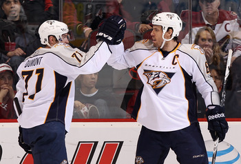 GLENDALE, AZ - JANUARY 18:  J.P. Dumont #71 and Shea Weber #6 of the Nashville Predators celebrate after Dumont scored his second goal of the game against the Phoenix Coyotes during the second period of the NHL game at Jobing.com Arena on January 18, 2011