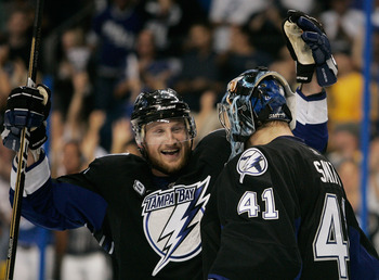 TAMPA, FL - MAY 21:  Steven Stamkos #91 and Mike Smith #41 of the Tampa Bay Lightning celebrate after defeating the Boston Bruins 5 to 3 in Game Four of the Eastern Conference Finals during the 2011 NHL Stanley Cup Playoffs at St Pete Times Forum on May 2