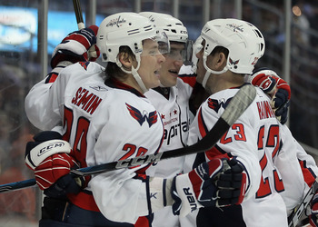 ANAHEIM, CA - FEBRUARY 16:  (L-R) Alexander Semin #28, Alex Ovechkin #8 and Dave Hannan #23 of the Washington Capitals celebrate Semin's first goal of the game against the Anaheim Ducks in the second period at the Honda Center on February 16, 2011 in Anah