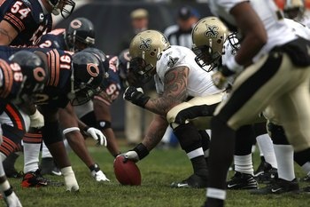CHICAGO - DECEMBER 30:  Center Jeff Faine #52 of the New Orleans Saints centers the ball at the line of scrimmage against Tommie Harris #91 the Chicago Bears along with the rest of the Bears defense at Soldier Field on December 30, 2007 in Chicago, Illino