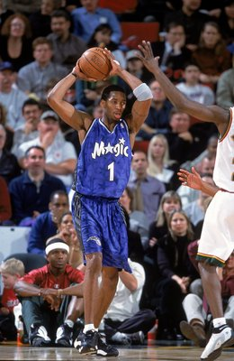 12 Dec 2000:  Tracy McGrady #1 of the Orlando Magic with the ball during the game against the Seattle SuperSonics at the Key Arena in Seattle, Washington.  The SuperSonics defeated the Magic 97-92.    NOTE TO USER: It is expressly understood that the only