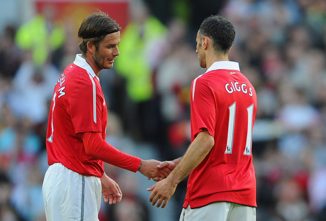 MANCHESTER, ENGLAND - MAY 24:  Ryan Giggs of Manchester United shakes hands with David Beckham as he is subbed during the Gary Neville Testimonial Match between Manchester United and Juventus at Old Trafford on May 24, 2011 in Manchester, England.  (Photo
