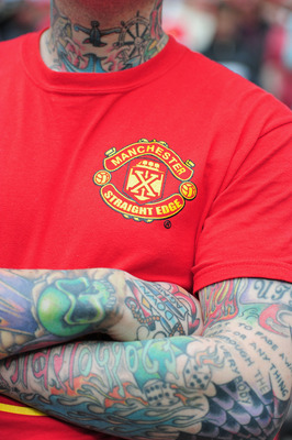 LONDON, ENGLAND - APRIL 16:  A tattooed Man United fan soaks up the atmosphere during the FA Cup sponsored by E.ON semi final match between Manchester City and Manchester United at Wembley Stadium on April 16, 2011 in London, England.  (Photo by Jamie McD