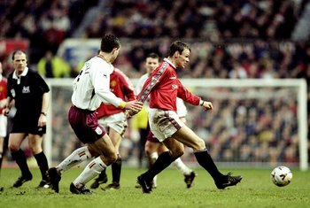 26 Dec 1999:  Teddy Sheringham of Manchester United is watched by David Wetherall of Bradford City during the FA Carling Premiership match at Old Trafford in Manchester, England. United won 4-0. \ Mandatory Credit: Alex Livesey /Allsport