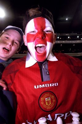 15 Jul 1999:  A young Manchester United fan shows his support during the friendly match against Australia played at the Melbourne Cricket Ground in Melbourne, Australia.  The match finished in a 2-0 win for Manchester United. \ Mandatory Credit: Jack Atle
