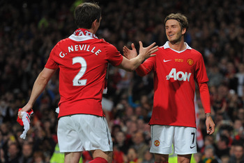 MANCHESTER, ENGLAND - MAY 24: David Beckham shakes hands with Gary Neville after the Gary Neville Testimonial Match between Manchester United and Juventus at Old Trafford on May 24, 2011 in Manchester, England.  (Photo by Michael Regan/Getty Images)