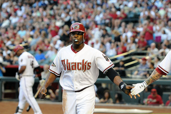 PHOENIX, AZ - JUNE 17:  Justin Upton #10 of the Arizona Diamondbacks celebrates with teammates after scoring a run in the first inning against the Chicago White Sox at Chase Field on June 17, 2011 in Phoenix, Arizona.  (Photo by Norm Hall/Getty Images)