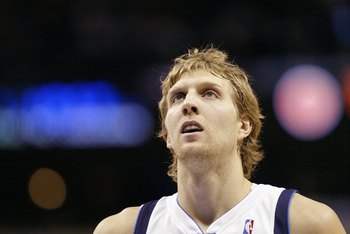 DALLAS - DECEMBER 7:  Dirk Nowitzki #41 of the Dallas Mavericks looks up during the NBA game against the Detroit Pistons at American Airlines Center on December 7, 2006 in Dallas, Texas. NOTE TO USER: User expressly acknowledges and agrees that, by downlo