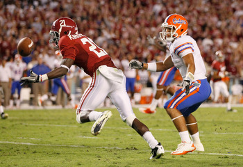 TUSCALOOSA, AL - OCTOBER 02:  Dre Kirkpatrick #21 of the Alabama Crimson Tide intercepts a pass intended for Trey Burton #8 of the Florida Gators at Bryant-Denny Stadium on October 2, 2010 in Tuscaloosa, Alabama.  (Photo by Kevin C. Cox/Getty Images)