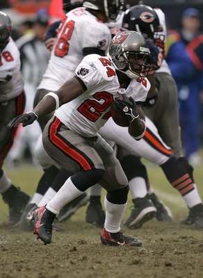 CHICAGO - DECEMBER 17:  Running back Carnell 'Cadilac' Williams #24 of the Tampa Bay Buccaneers runs the ball against the Chicago Bears December 17, 2006 at Soldier Field in Chicago, Illinois.  (Photo by Jonathan Daniel/Getty Images)