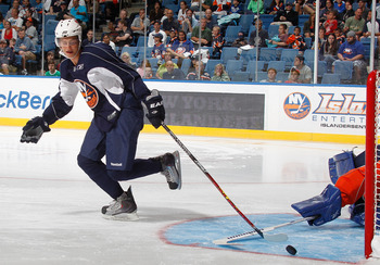 UNIONDALE, NY - JULY 10: Islanders Kirill Kabanov (L) reaches out for the puck in a skills competition during the New York Islanders Rookie camp at Nassau Veterans Memorial Coliseum on July 10, 2010 in Uniondale, New York.  (Photo by Paul Bereswill/Getty