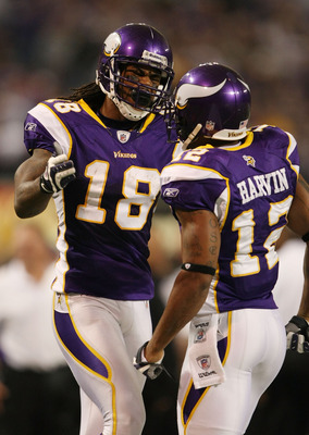 MINNEAPOLIS - NOVEMBER 15: Sidney Rice #18 of the Minnesota Vikings congratulates teammate Percy Harvin #12 after Harvin made a 40 yard run in the fourth quarter against the Detroit Lions on November 15, 2009 at Hubert H. Humphrey Metrodome in Minneapolis