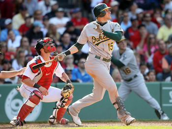 BOSTON, MA - JUNE 04:  Ryan Sweeney #15 of the Oakland Athletics hits a sacrifice fly to score teammate Cliff Pennington in the eleventh inning as Jarrod Saltalamacchia #39 of the Boston Red Sox catches on June 4, 2011 at Fenway Park in Boston, Massachuse