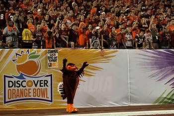 MIAMI, FL - JANUARY 03:  Hokie Bird, mascot of the Virginia Tech Hokies stands on the field in front of students and fans against the Stanford Cardinal during the 2011 Discover Orange Bowl at Sun Life Stadium on January 3, 2011 in Miami, Florida. Stanford